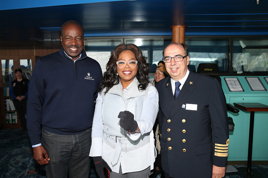 Holland America President Orlando Ashford and Eurodam Captain show Oprah around the bridge.