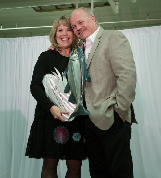 Visit Anchorage CEO Julie Saupe presents the Alyeska Award to Al Koch of All Alaska Tours. Photo courtesy ATIA