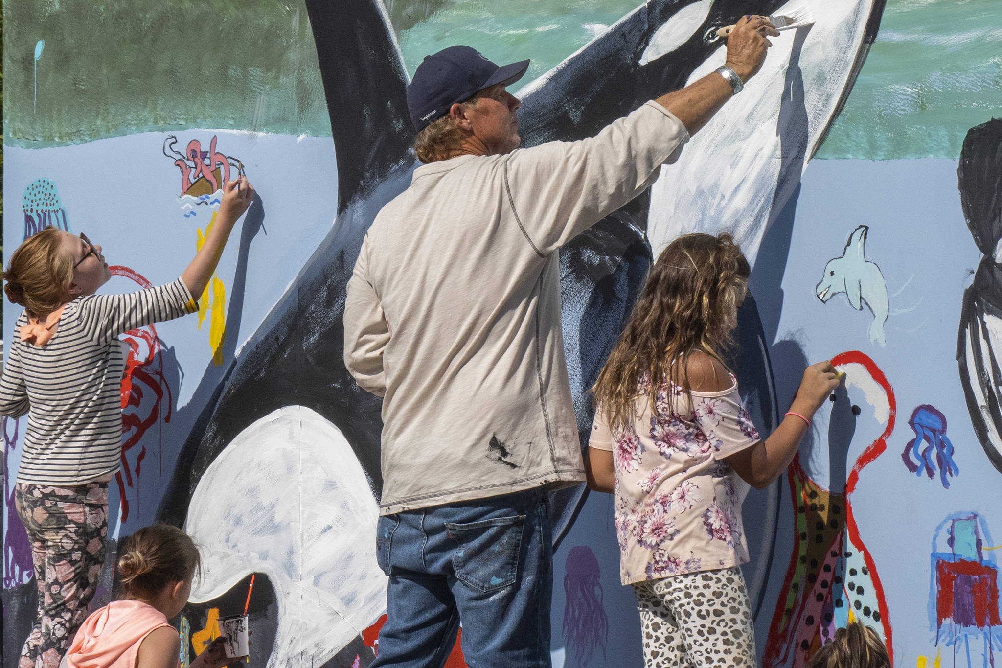 Artists, kids paint mural at Icy Strait Point in Hoonah