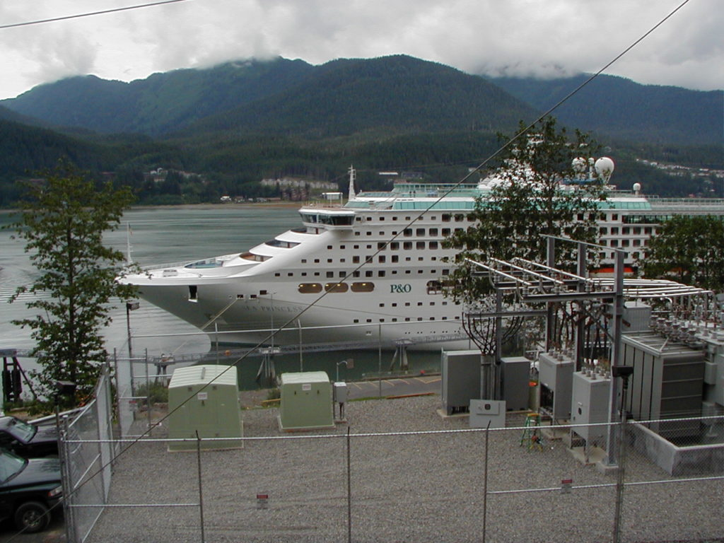 Sea Princess at Franklin Dock in Juneau with Princess Cruises' shore power transformer in the foreground.